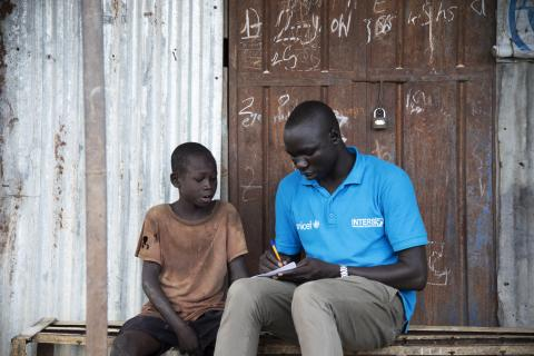Caseworker Simon Char is recording information about Falluoch Jeremia, 11, and his family. He hasn't seen his parents in two years. Last time they saw each other was when bullets were flying in Malakal. They got separated and haven't seen each other since. The information recorded, Simon will use to try and locate his parents. UNICEF and partners have reunified close to 6000 children since the conflict broke out in 2013. Still, over 12,000 children are waiting for family tracing and reunification.