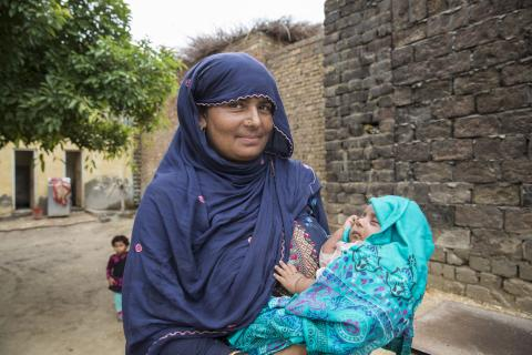 A mother holds her newborn baby, Pakistan