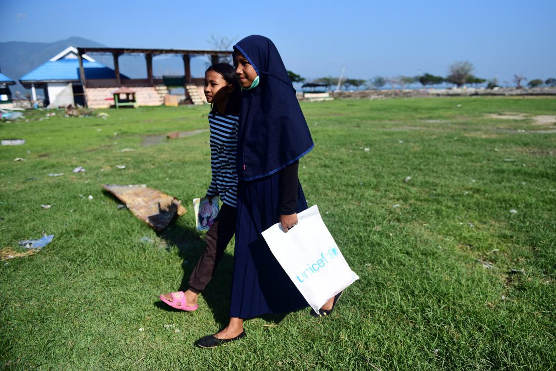 Indonesia earthquake and tsunami. Two displaced students walk to school.